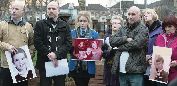 Left: Family and friends of Bloody Sunday victims gathered at the memorial for a minute's silence at the anniversary and John Kelly, whose brother Michael was killed on Bloody Sunday, addresses family members at the event