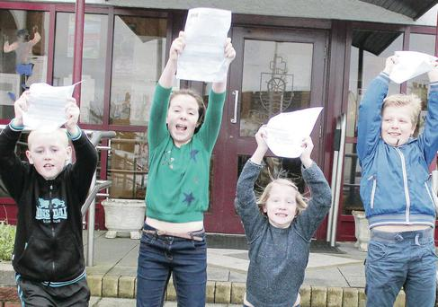 Pupils at Millburn Primary School in Coleraine celebrate their successful transfer test results