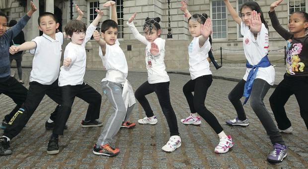 Children from the Urban Marshall Arts preform pictured at Belfast City Hall