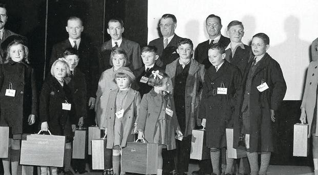 Belfast blitz orphans with their suitcases at Lockheed