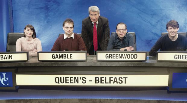 Question time: The Queen's University team with quiz host Jeremy Paxman
