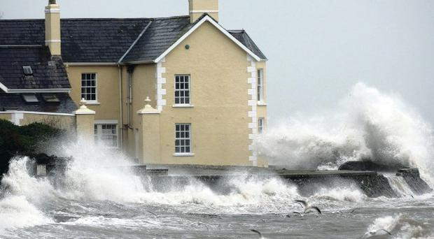 A house at Drains Bay is battered by strong winds, rain, and high tide in Co Antrim