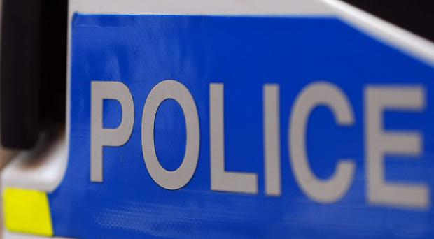 Police are holding a man after a stabbing in Belfast