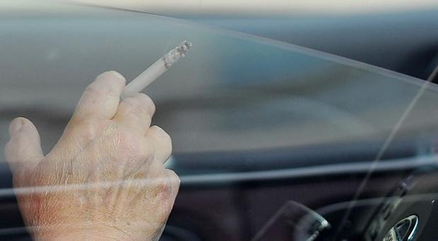 A charity wants Northern Ireland MPs to back a ban on smoking in cars carrying children