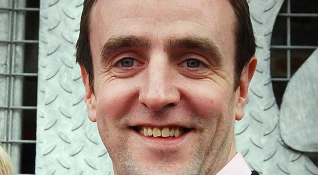 Mark H Durkan is overseeing the merger