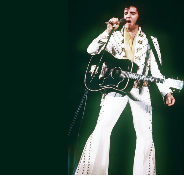 The king of rock 'n' roll Elvis Presley struts his stuff during a gig in 1973