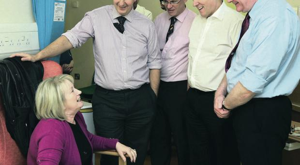 Catherine McCarley, a patient to be assessed to donate an organ at Belfast City Hospital waiting pictured last year, meeting with Health Minister Edwin Poots, campaigner Joe Brolly and First Ministers Peter Robinson and Martin McGuinness