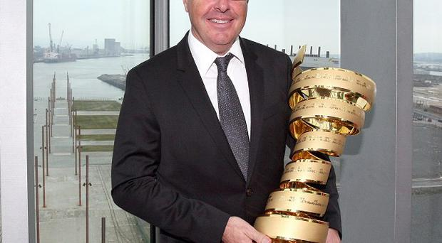 Stephen Roche holds the Giro d'Italia trophy at the Titanic building in Belfast.