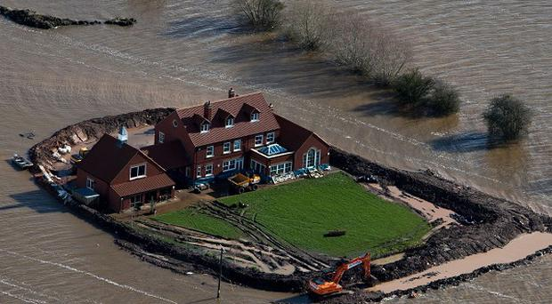 A house near the flooded village of Moorland in Somerset owned by Sam Notaro, who has built his own flood defences