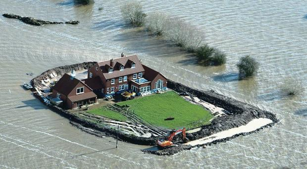A house near the flooded village of Moorland in Somerset where the owner has built his own flood defence