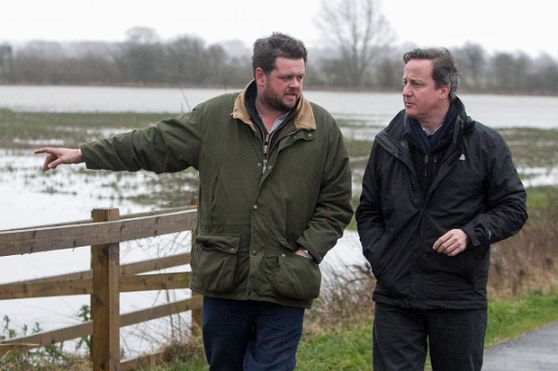 David Cameron talks with farmer Tim Hook near Bampton, in Oxfordshire.