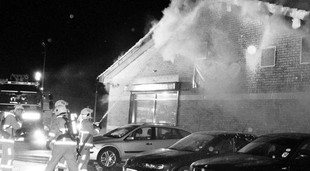 Firefighters battle to get the blaze at the Yoko Bistro and Noodle Bar in Coleraine