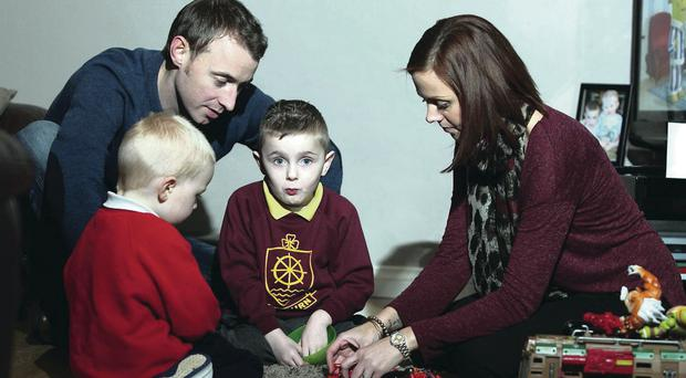 Oliver Dickey (centre) with his mum Charlene, dad Neil and younger brother Max