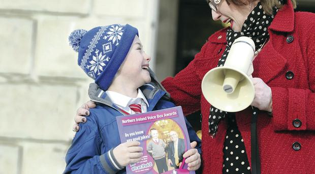Royal College of Speech and Language Therapists' Anne Gamble and reigning champion Conor Heaveron are encouraging pupils to enter the joke-telling contest later this year