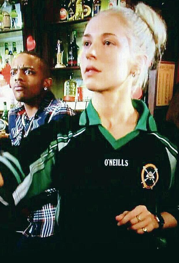 Actress Maddy Hill, as Nancy Carter in EastEnders, wearing the St Patrick's Ballymena top