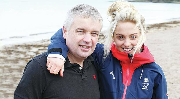 Snowboarder Aimee Fuller with her dad Chris at Helen's Bay