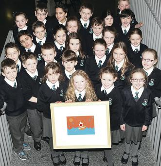 Overall winner Aimee Craig (9) and classmates from St Ita's PS, Belfast, with her picture 'Fishing in the Rain'