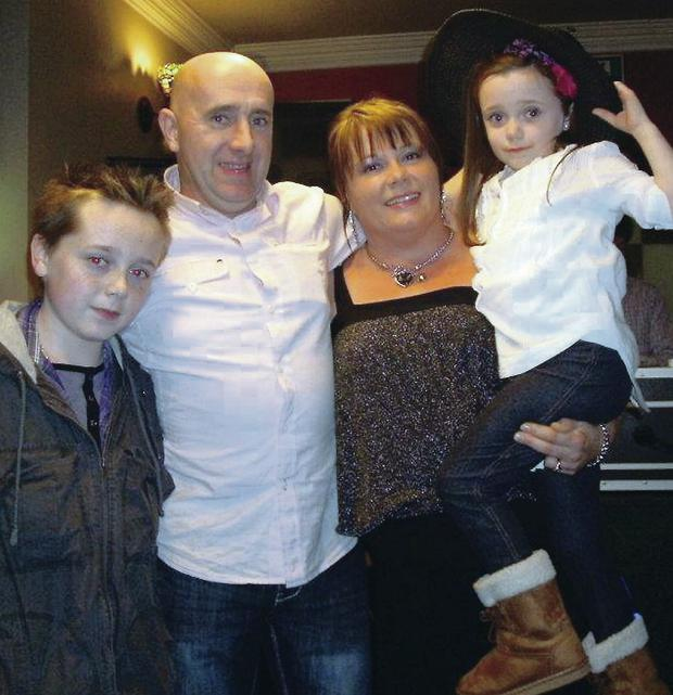 Paul Colhoun with his wife Marie, son Niall and daughter Shona