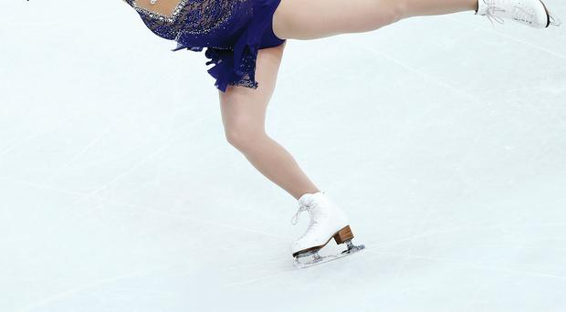 Jenna McCorkell competes in the figure skating ladies' short programme