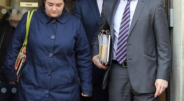 Family barrister Fiona Doherty and solicitor Padraig O Muirigh (right) leave Mays Chambers in Belfast