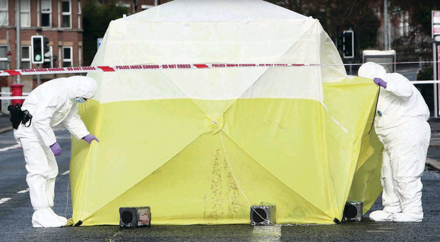 Forensic officers at the scene of the attack on the Antrim Road