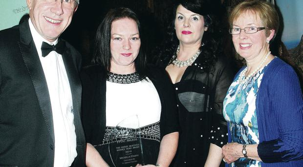 Leon Daniels of Surface Transport, Michelle Starr who received the Gerry McKenna Hidden Hero Award, Karen Magill of the Federation of Passenger Transport, and Dympna McKenna of RSA NI, at the Federation of Passenger Transport NI awards