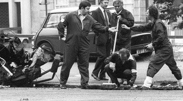 Police forensic officers working on the remains of the car which housed the Hyde Park car bomb in 1982.