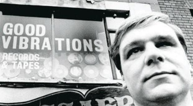 Punk rebel and shop owner Terri Hooley outside Good Vibrations
