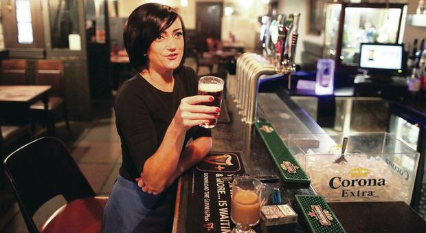 Marguerita Sloan enjoys a drink in White's Tavern