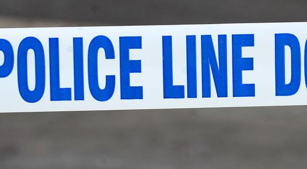 Two people have been arrested over the death of a man found injured in the street