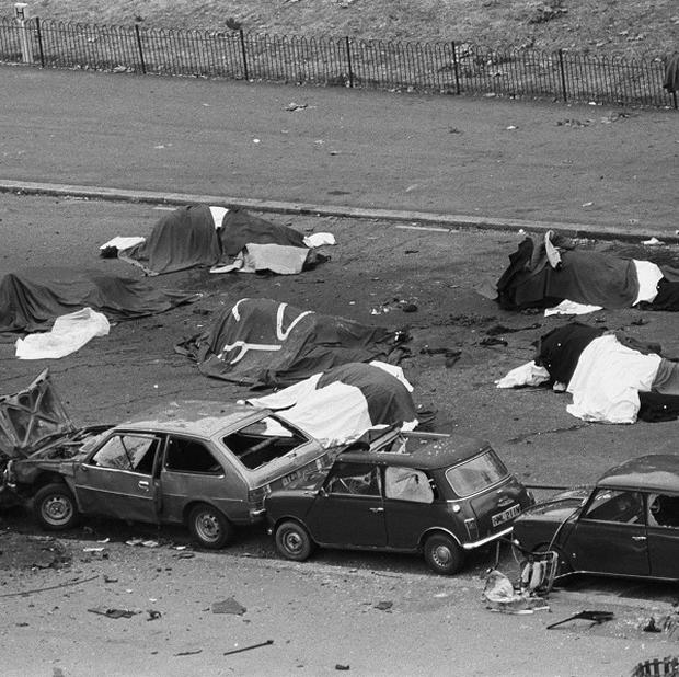Dead horses and wrecked cars at the scene after an IRA bomb exploded as the Household Cavalry was passing in Hyde Park, London, in 1982