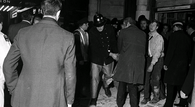 The shocked crowd outside The Tavern in the Town pub in Birmingham after the 1974 bombings