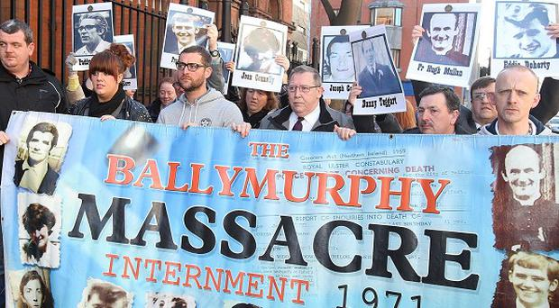 Protesters outside Belfast Coroner's Court at the start of a new inquest into the deaths of 10 people shot dead in Belfast in 1971.