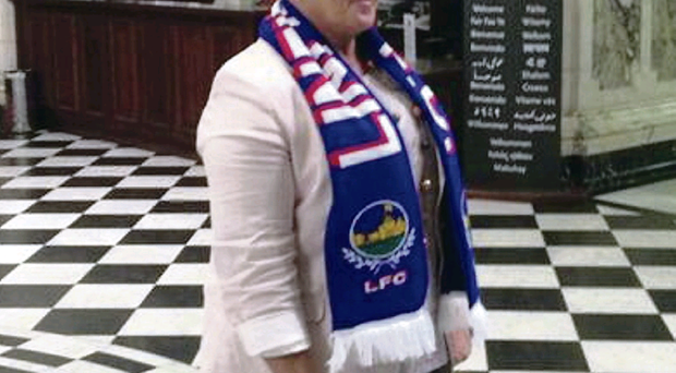 DUP councillor Ruth Patterson wearing a Linfield scarf at City Hall