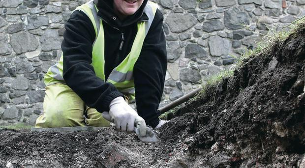 Archaeologist Naomi Carver digging at Carrickfergus Castle