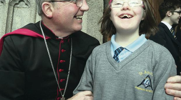Bishop Donal McKeown, with Emma McDaid (12), a pupil of St Anne's Primary School