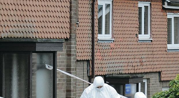 Forensic officers examine the scene in the Lincoln Court area of Londonderry where a pipe bomb was discovered