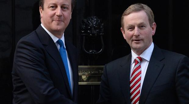 Prime Minister David Cameron greets Taoiseach Enda Kenny at the door of 10 Downing Street