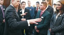 The Duke of York talks to some of the apprentices at the Belfast Telegraph yesterday