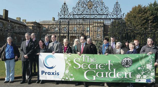 Politicians join Praxis supporters to protest at the gates of Hillsborough Castle