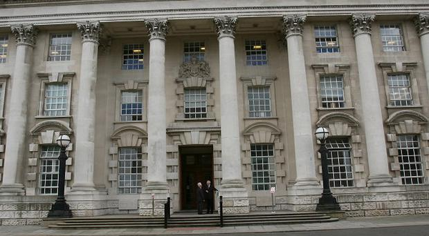 Four men appeared at Belfast Crown Court to admit animal cruelty charges