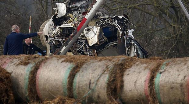 The wreckage of a helicopter after a crash which left four people dead