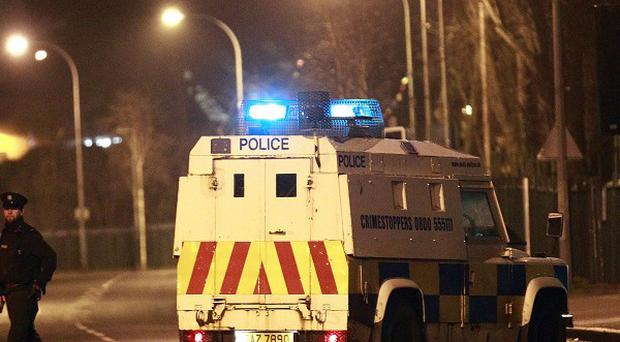 Police secure the Falls Road close to the scene of a bomb attack in West Belfast (AP)