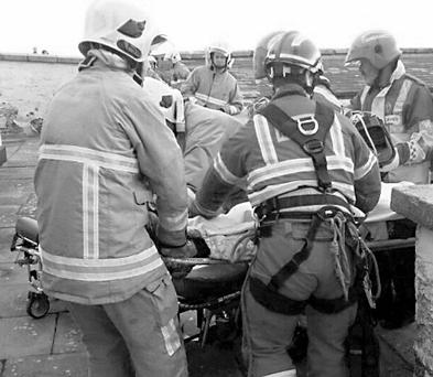 The injured man is taken away from the lighthouse