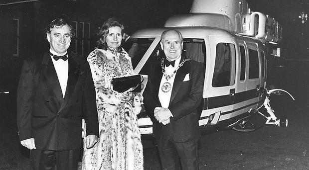 Eddie Haughey and his wife Mary arriving at a function in his helicopter