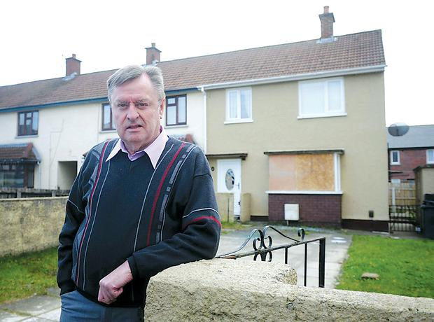 Fraser Agnew inspects damage caused to a house at Ballyronan Park in Newtonabbey