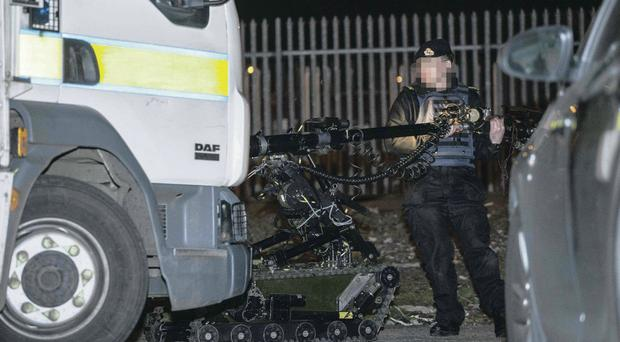 An Army ammunition technical officer at the scene of the security alert at Donegall Avenue which disrupted rail services