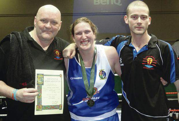 Fiona Nelson celebrates the win with her coaches Sandy O'Neil (right) and Terry McCorran