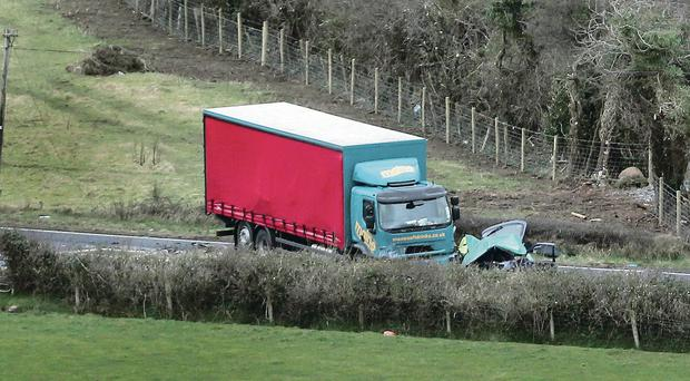 The scene of the fatal crash between a lorry and a car on the main road between Coleraine and Limavady