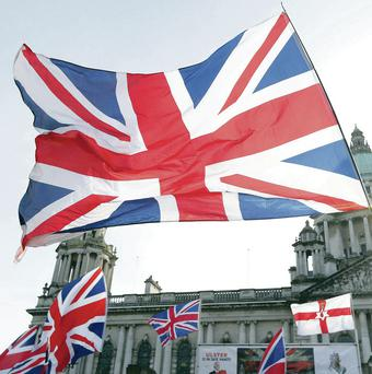 Union flags flying at Belfast City Hall as part of a protest in February 2013